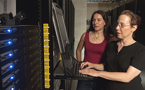 Rachel Karchin, right, an assistant professor of biomedical engineering, and doctoral student Hannah Carter led a Johns Hopkins team that developed software to narrow the search for mutations linked to cancer. Photo by Will Kirk.