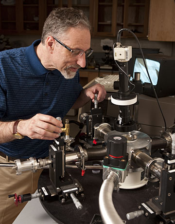In his material science lab, Howard Katz adjusts probes used for testing electronic devices. Photo by Will Kirk Homewoodphoto.jhu.edu