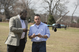 Lanier A. Watkins, left, a Johns Hopkins cyber security research scientist, worked with five graduate students, including Michael Hooper, at right, to determine that the technology used in a hobby drone was vulnerable to hacking. Photo by Will Kirk/Johns Hopkins University.